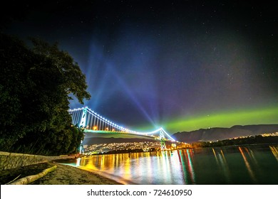 Aurora (Northern Lights) with lights of Lions Gate Bridge, Vancouver, BC, Canada