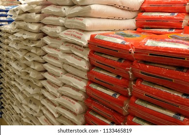 Aurora, Ontario / Canada - July 12 2018: Stacks Of Rice Bags Are On Display At A Grocery Store. A Local Grocer Is Selling Various Bags Of Rice. International Rice Is Sold At A Local Grocer.