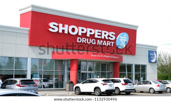 Aurora, Ontario / Canada - July 12 2018:  A Shoppers Drug Mart Store Front In Aurora, Ontario, Canada. Shoppers Drug Mart Is A Corporation That Is Owned By Loblaw Companies. Pharmacy And Misc Merchant
