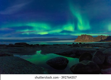 Aurora over the sea at Utakleiv beach, Lofoten Islands, Norway