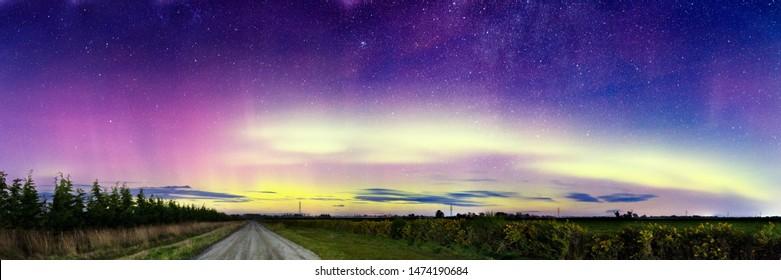 Aurora southern lights over rural road landscape, Aurora Australis, Polar lights, Colorful lights in night sky, Beautiful nature background, Wide scenic panorama, Aurora Borealis, Stars galaxy nebula