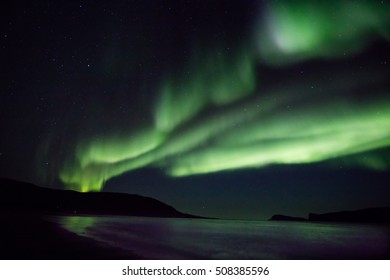 Aurora waves over the skies of Tromso