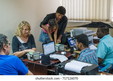 Auroville, India - September 2017: People applying to get the Aadhaar Card, an easily verifiable 12 digit random number as Unique Identity. The Aadhaar Card is mandatory for all residents of India.