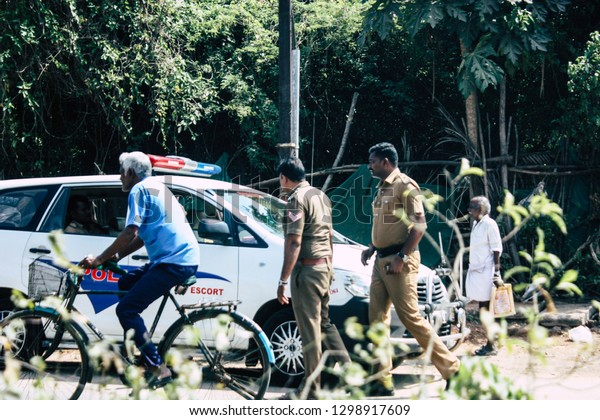 Auroville Tamil Nadu January 24, 2019 View of Indian police officers controlling cars at the road to Auroville in southern India in the afternoon