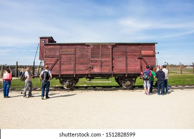 Auschwitz, Auschwitz/Poland - 04.20.2019: Abandoned train wagon in the rail entrance to concentration camp at Auschwitz Birkenau. Death train used to transport Jews during the holocaust to Auschwitz.