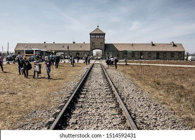 Auschwitz, Auschwitz/Poland - 04.20.2019: Auschwitz Birkenau Main Gate, Rail Entrance to the German Nazi Concentration Camp, here were exterminated 1.5 million people. Holocaust concept.