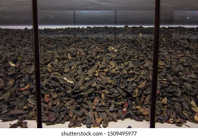 Auschwitz, Auschwitz/Poland - 04.20.2019: Shoes, boots of victims of Holocaust. Remaining belongings of the people killed in Auschwitz Birkenau nazi concentration camp in Europe. Selective focus