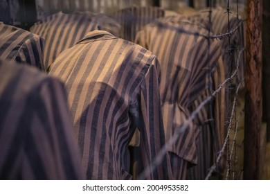 Auschwitz Birkenau, Poland, 05.07.2021.Group of mannequins in stripe clothes, shows how in the terrible conditions people where kept in old nazi concentration camp.