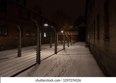 Auschwitz Birkenau, Poland 27 January 2019: Part of Auschwitz Concentration Camp Holocaust Memorial Museum by night, Arbeit Macht Frei, winter