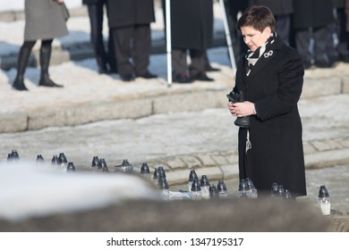 Auschwitz- Birkenau, Poland - 27 January 2017: 72 th Anniversary of the Liberation of Auschwitz. Prime Minister of Poland Beata Szydlo light candles at the monument