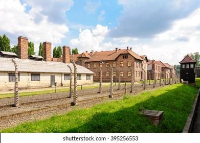 Auschwitz I - Birkenau, rear view of kitchen, Block 25, fence and watch tower