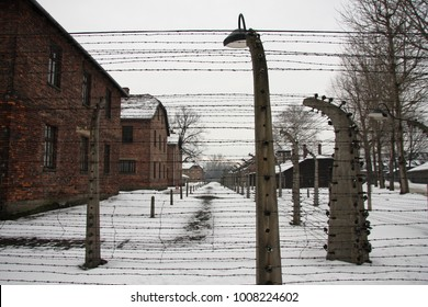 The Auschwitz counter-camp (Poland, Krakow). The liberation of Auschwitz. Barracks for prisoners behind barbed wire. Winter.