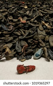 Auschwitz, Lesser Poland / Poland - Feb 04 2018: Auschwitz Birkenau, Nazi concentration and extermination camp. Pile of shoes from the victims of holocaust