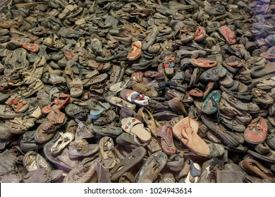 Auschwitz, Lesser Poland / Poland - Feb 04 2018: Auschwitz Birkenau, Nazi concentration and extermination camp. Pile of shoes from the victims of holocaust.