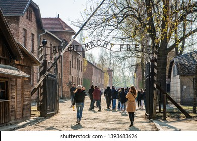 "AUSCHWITZ (OSWIECIM), POLAND - APRIL 18, 2019: Main Entrance Gate with ""ARBEIT MACHT FREI"" (Work leads to freedom) Slogan in Auschwitz I (main camp) in Oswiecim, Poland"