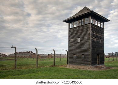 Auschwitz, Oswiecim / Poland - October 27, 2018: Guard tower. Barbed wire in a concentration camp. Fence under electric current. Museum of the Holocaust in Oswiecim.