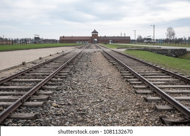 Auschwitz, Poland. April 2018. The main entrance to Auschwitz Birkenau Nazi Concentration Camp showing the train tracks used to bring Jews and other minority groups to their death in cattle cars.