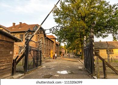 AUSCHWITZ, POLAND - AUGUST 27, 2017: Arbeit macht frei sign on the main entrance gateway to Auschwitz-Birkenau (Auschwitz I) concentration camp near Oswiecim city, Poland