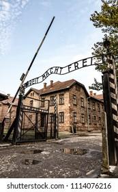 "AUSCHWITZ, POLAND - AUGUST 27, 2017. Arbeit Macht Frei sign on entrance gateway to Auschwitz-Birkenau concentration camp (Auschwitz I) near Oswiecim, Poland. German phrase means ""Work sets you free"""