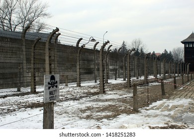 Auschwitz, Poland - January, 2019. Rows of barbed wire along the fence of the Auschwitz death camp