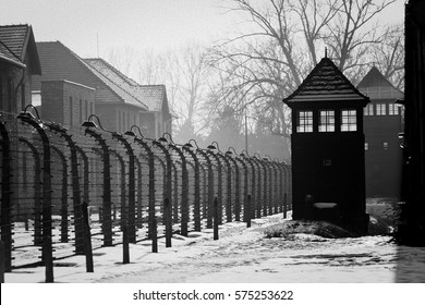 AUSCHWITZ, POLAND - JANUARY 28, 2018 ; Shed guard in Auschwitz. Museum Auschwitz - Birkenau, holocaust museum. Anniversary Concentration Camp Liberation. Barbed wire around a concentration camp.