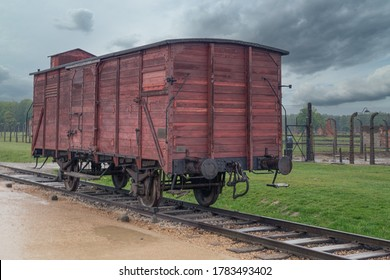 Auschwitz, Poland - May 15, 2019: WW2 train wagon in the rail entrance to concentration camp at Auschwitz Birkenau, used to transport Jews during the holocaust.