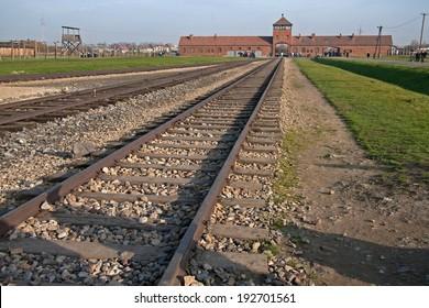 Auschwitz, Poland - November 5, 2008: Infamous gate and railroad leading to Auschwitz-Birkenau.