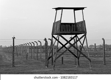 AUSCHWITZ, POLAND, OCTOBER 12, 2013: Watchtower and fence at concentration camp at Auschwitz Birkenau KZ, black and white photography, Poland, Europe