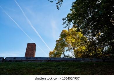 AUSCHWITZ, Poland - September 30, 2018: Brick chimney of the crematorium in the biggest nazi concentration camp in Europe during World War II in Auschwitz city in Poland