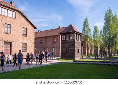 AUSCHWITZ-BIRKENAU CONCENTRATION CAMP, POLAND - JUNE, 2017: Auschwitz concentration camp watchtower and fence