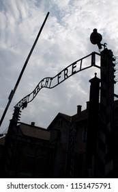 Auschwitz-Birkenau / Poland - 07/27/2018: Arbeit Macht Frei sign on entrance gateway to Auschwitz-Birkenau concentration camp (Auschwitz I) , Poland
