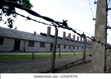 Auschwitz-Birkenau / Poland - 07/27/2018: barbed wire fence at Auschwitz-Birkenau concentration camp