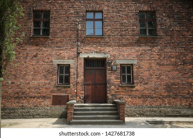 Auschwitz-Birkenau, Poland - 14 June 2019: National Day of Remembrance for Victims of German Nazi concentration and extermination camps. Building of the 10th KL Auschwitz block, medical experiments