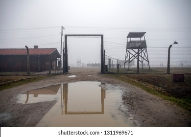 Auschwitz-Birkenau, Poland/February 10, 2019 ; Auschwitz - Birkenau, the inner gate in the concentration camp. Exit from the train station to the death camp. German concentration camp in Poland.
