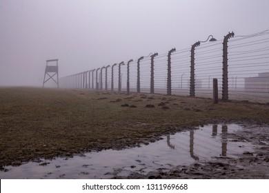 Auschwitz-Birkenau, Poland/February 10, 2019 ;Auschwitz-Birkenau concentration camp. Death barrack. Jewish extermination camp. German death camp in Oświęcim. Barbed wire around from the camp.