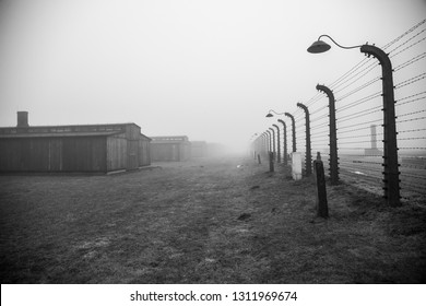 Auschwitz-Birkenau, Poland/February 10, 2019 ;Auschwitz-Birkenau concentration camp. Death barrack. Jewish extermination camp. German death camp in Oświęcim. Barbed wire around from the camp.