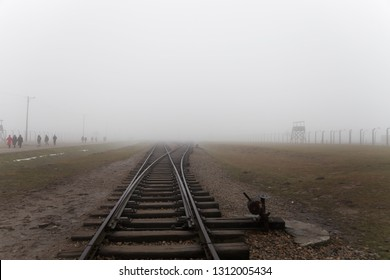 Auschwitz-Birkenau, Poland/February 10, 2019 ; Auschwitz-Birkenau concentration camp. The tracks in the Jewish extermination camp. German death camp in Oświęcim. Barbed wire around from the camp.