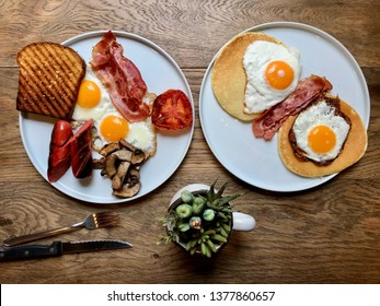 Aussie / Australian Breakfast with Brioche Toast, Fried Eggs, Crispy Bacon Sausage, Salty Pancakes and Mushrooms.