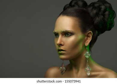 austere beauty portrait of a girl in a green glow. looks into the distance.