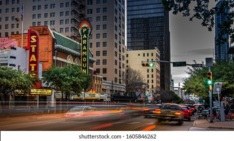 Austin, TX—Jan 8, 2019; time exposure of cars on congress ave passing in front of the iconic State and Paramount theater venues at dusk.