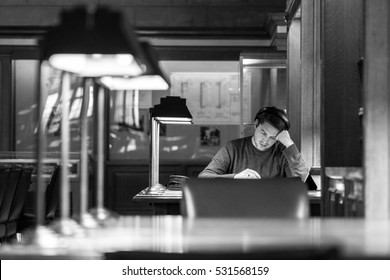 AUSTIN - CIRCA APRIL 2016: A college student studies at a library on the campus of the University of Texas at Austin.