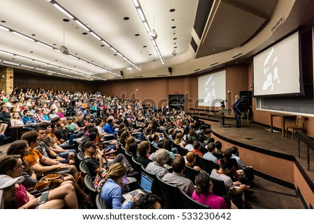 AUSTIN - CIRCA APRIL 2016: Professor Neil Shubin delivers a lecture to a large audience of college students at the University of Texas at Austin.