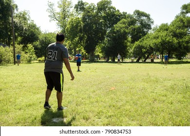 AUSTIN - CIRCA APRIL 2016: Students of the University of Texas play kickball at a local park at the beginning of spring.