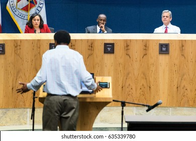 AUSTIN - CIRCA FEBRUARY 2016: Citizens of Austin, Texas attend and speak at a public hearing to discuss the future of Uber and Lyft ride hailing services in the city at City Hall in downtown.