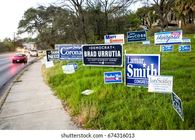 AUSTIN - CIRCA FEBRUARY 2016: Political campaign signs for the midterm election are displayed on the side of the road in Austin, Texas.