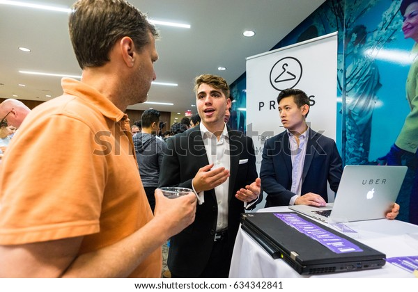 AUSTIN - CIRCA FEBRUARY 2016: Students at the University of Texas pitch ideas for their startup companies at a trade conference in Austin, Texas.
