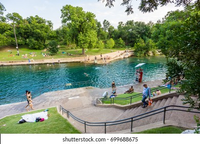 AUSTIN - CIRCA JULY 2017: Tourists and swimmers enjoy the cool natural water of Barton Springs pool in Austin, Texas.