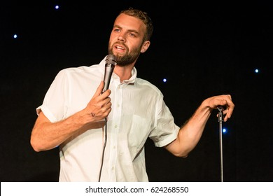 AUSTIN - CIRCA MARCH 2016: Comedian Brooks Whelan performs stand up comedy and tells jokes at a theater in downtown Austin, Texas.