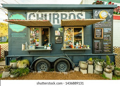 AUSTIN - CIRCA MAY 2019: People eat at a local food truck called Austin Churro Co. in east Austin, Texas. The food truck a wide variety of delicious desserts.