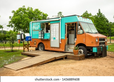 AUSTIN - CIRCA MAY 2019: People eat at a local food truck called Vera Cruz in east Austin, Texas. The food truck a wide variety of Venezuelan cuisine and tacos.